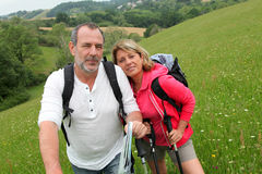 Cenior couple on a hiking journey Royalty Free Stock Photo
