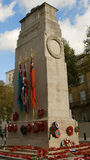 Cenotaph. The cenotaph memorial, whitehall, london, on armistice day. Poppies at base stock photo