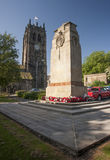 Cenotaph at Halifax Minster. The cenotaph dedicated to the people who died in the World War I and II in front of the Halifax Minster in West Yorkshire in England stock photo
