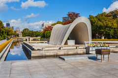 Cenotaph at Hiroshima Peace Memorial Park. Hiroshima, Japan - November 15 2013: Memorial cenotaph at the center of the park is a saddle-shaped monumen covers a Royalty Free Stock Photos