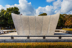 Cenotaph at Hiroshima Peace Memorial Park. HIROSHIMA, JAPAN - NOVEMBER 15: Peace Memorial Park in Hiroshima, Japan on November 15, 2013. Memorial cenotaph at the Royalty Free Stock Images