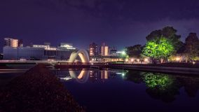 The Cenotaph and Pond at Peace Memorial Park by night in Hiroshima, Japan. royalty free stock image