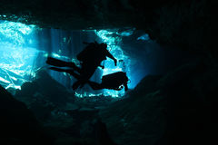 Cenote Diving. Divers in Chacmool Cenote, Playa del Carmen, Mexico Stock Photo
