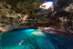 Cenote Samula Dzitnup near Valladolid, Yucatan, Mexico - swimming in crystal blue water stock photos