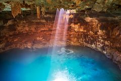 Cenote Samula sinkhole in Valladolid Mexico. Cenote Samula sinkhole light beam near Valladolid in Yucatan Mexico Royalty Free Stock Image