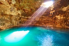 Cenote Samula sinkhole in Valladolid Mexico. Cenote Samula sinkhole light beam near Valladolid in Yucatan Mexico Stock Photography