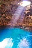 Cenote Samula sinkhole in Valladolid Mexico. Cenote Samula sinkhole light beam near Valladolid in Yucatan Mexico Stock Image