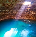 Cenote Samula sinkhole in Valladolid Mexico. Cenote Samula sinkhole light beam near Valladolid in Yucatan Mexico Stock Photos
