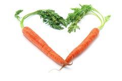 Cenouras arranjadas na forma do coração imagem de stock royalty free