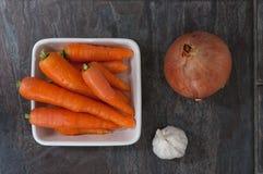 Cenouras, cebola e alho Imagens de Stock Royalty Free
