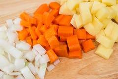 Cenouras cortadas & batatas cortadas Imagem de Stock