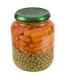 Cenouras e ervilhas de bebê em um frasco imagem de stock royalty free