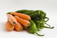 Cenouras e pimentas Fotos de Stock