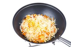 Cenouras e raiz de aipo desbastadas na frigideira Foto de Stock Royalty Free
