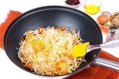 Cenouras e raiz de aipo desbastadas na frigideira Imagem de Stock Royalty Free
