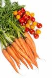 Cenouras e tomates Fotografia de Stock Royalty Free