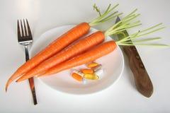 Cenouras e vitaminas Imagens de Stock Royalty Free