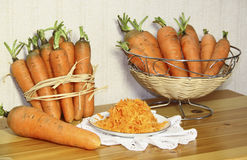 Cenouras frescas em uma tabela Imagem de Stock