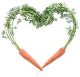 Cenouras frescas que dão forma a um coração Imagens de Stock Royalty Free