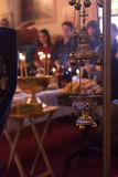 Censer. In foreground, priest hand blessing the faithful during service in church in background stock photo