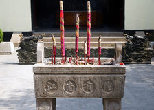 Censer and incense. A censer meant for burning incense in front of a Chinese house or temple Royalty Free Stock Photo