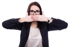 Censor - stressed young business woman covering her mouth isolat. Censorship concept - stressed young business woman covering her mouth isolated on white Royalty Free Stock Photos