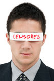 Censored. Young businessman with a band on his eyes Royalty Free Stock Photography