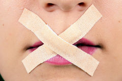 Censored Beauty. A censored mouth with tape over the lips Royalty Free Stock Photos