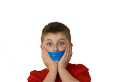 Censored Boy with hands. A boy is censored by blue tape with hands on cheeks Royalty Free Stock Images