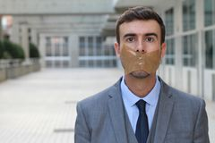 Censored businessman unable to express his opinion Royalty Free Stock Photo