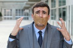 Censored businessman unable to express his opinion Stock Photos