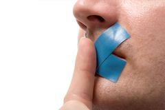 Censored Man blue tape, Finger. Censored Man with blue tape on his mouth. Finger before lips. Isolated on white. Psssssst royalty free stock photos