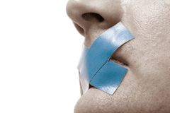 Censored Man blue tape, toned. Censored Man with blue tape on his mouth. Toned Image. Isolated on white stock image