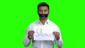 Censored man holding card with inscription Silence. Chroma Key background. Freedom of speech concept stock footage