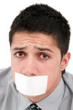 Censored speech. A young businessman with a band on his mouth Stock Image