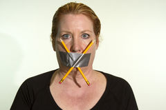 Censoring Free Speech, Free Press. Censorship of Freedom of Speech or Freedom of Press expressed by a woman with duct tape and pencils over her mouth stock image