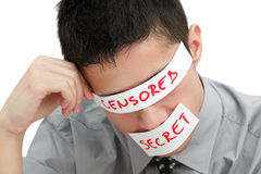 Censorship. Young businessman with a band on his eyes and mouth Stock Image
