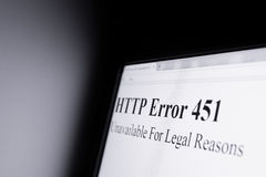 Censorship on internet. HTTP error 451 Unavailable For Legal Reasons - Shining computer screen in dark space - censorship and blocking internet pages because of stock photos