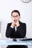 Censorship at work. Businesswoman covering her mouth with hands not to say anything immoral during work Stock Image