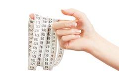 Centímetro en una mano femenina Foto de archivo