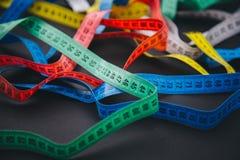 Centímetros diferentes para costurar na tabela Imagens de Stock