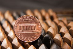 Cent and abacus Stock Photo