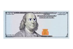 Cent billets de banque du dollar avec le portrait de Benjamin Franklin avec les yeux et l'espace étranges de copie pour votre ins photographie stock libre de droits