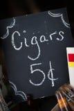 5 Cent Black Cigar Chalkboard Sign. Simple black chalkboard sign offering cigars royalty free stock photo