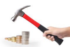 Cent coin and a hammer Stock Images