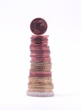 1 cent coin standing on top of stack of euro coins. Stock Photo