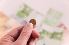 1 Cent in der Hand Stockfotos