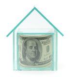 Cent dollars dans la maison en verre Images stock