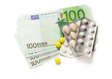 Cent euro billets de banque et pilules Photographie stock