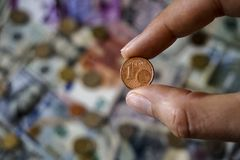 1 cent. In focus with money in the background Royalty Free Stock Photo